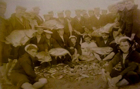 Men of HMS Hermione with a large catch of fish