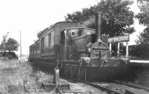 "Manning Wardle 2-4-0ST (saddle-tank) ""Lady Portsmouth"" waits to leave the bay at Fort Brockhurst with a Lee train in 1903. The level crossing gates can be seen in the background."