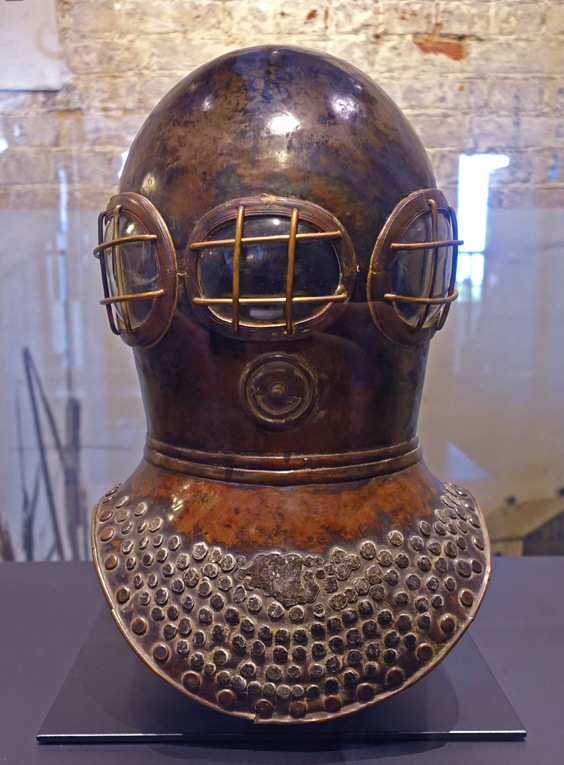 photo of the Deane helmet on display in the Diving Museum at Gosport.